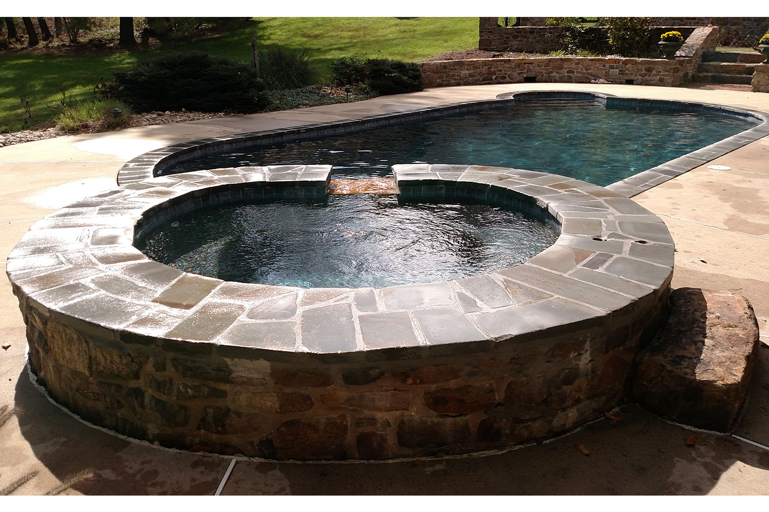 Complete Renovation, 2018: Alternate view of Tumbled Bluestone Coping, New Ceramic Tile and Pebble Tec Interior Finish, New Hope, PA