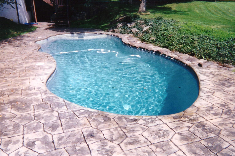 Renovation: Patterned Concrete, Cantilever Deck, Tile, Re-Plaster