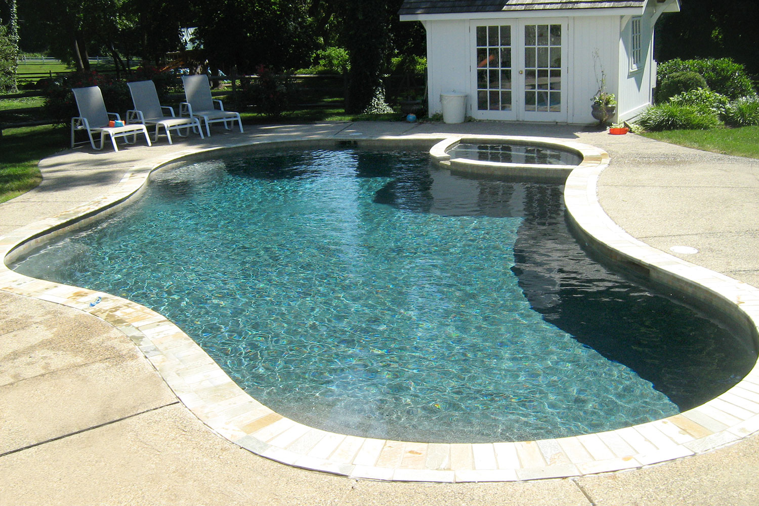 New Coping, Tile and Beautiful Pebble-Tec Interior Pebble Finish. Fully Automated Smart/Remote Pool/Spa Control System