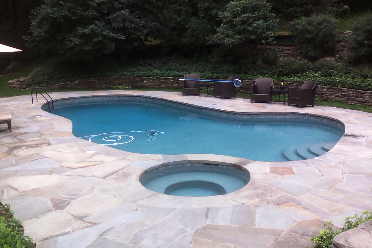 Complete Renovation: New Blue Stone Coping Integral with Deck, Tile, Beautiful Pebble-Tec Interior Finish, In-Pool LED Lighting and 9 Deck Fountains. Fully Automated Smart/Remote Pool/Spa Control System